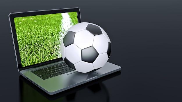 Computer portatile con pallone da calcio