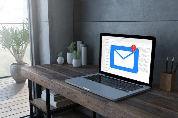 Computer portatile sul desktop in legno con rendering 3d della schermata di posta elettronica