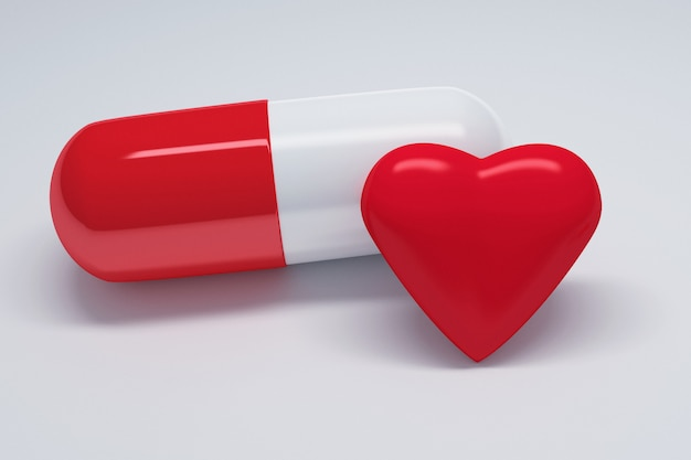 Capsula grande con capsula rossa e bianca e un grande cuore rosso lucido.