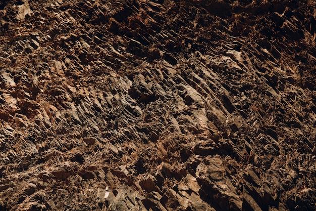 Motivo a strati di scogliera roccia trama. strati di pietra.