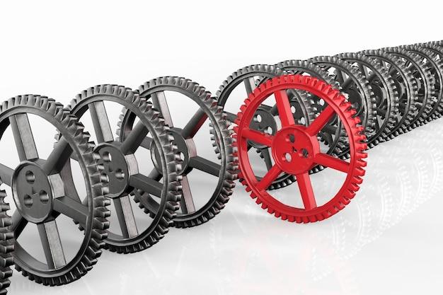 Concetto di leadership con ingranaggio rosso e ingranaggi in metallo