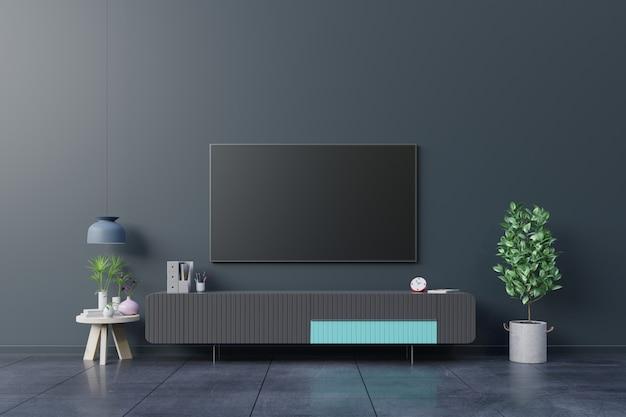 Tv led sulla parete scura in soggiorno