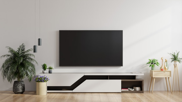 Tv led sul muro bianco in salotto, design minimale. Foto Premium