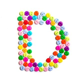 Lettera d dell'alfabeto inglese da un gruppo di piccoli pulsanti colorati su fondo bianco