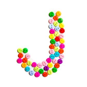 Lettera j dell'alfabeto inglese da un gruppo di piccoli pulsanti colorati su fondo bianco