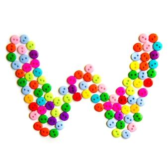 Lettera w dell'alfabeto inglese da un gruppo di piccoli pulsanti colorati su bianco