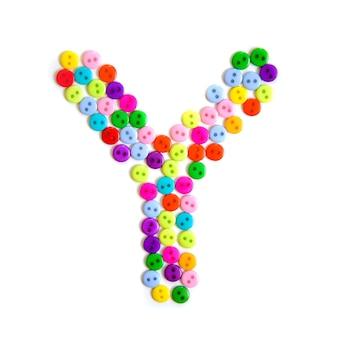 Lettera y dell'alfabeto inglese da un gruppo di piccoli pulsanti colorati su bianco