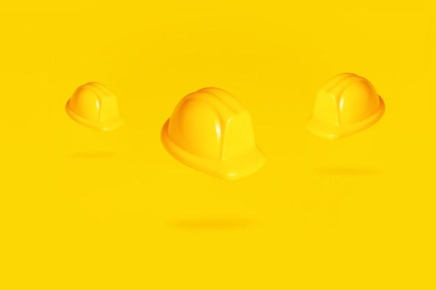 Elmetti protettivi fluttuanti su sfondo giallo, caschi in aria su sfondo giallo