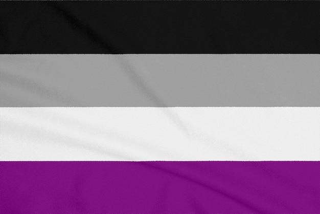 Bandiera comunità asessuata lgbt su tessuto testurizzato. simbolo di orgoglio