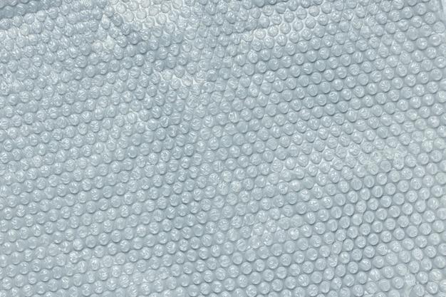 Pellicola a bolle azzurro per il confezionamento. close up, texture di sfondo, concetto di inquinamento