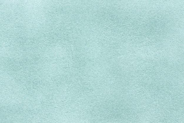 Sfondo azzurro opaco di tessuto scamosciato, primo piano. texture di velluto di sky feltro tessile, macro.
