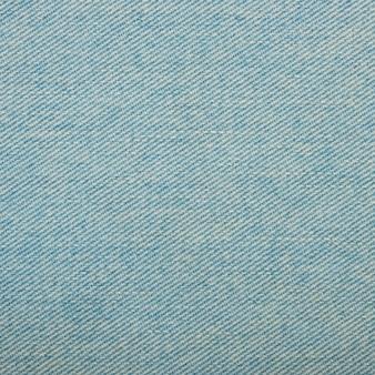 Fondo di struttura del denim dei jeans di cotone lavato azzurro chiaro, primo piano