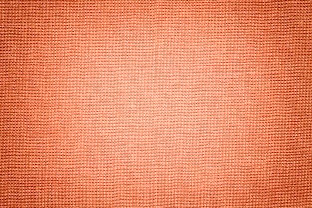 Corallo chiaro sfondo da un materiale tessile.