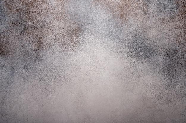 Sfondo grigio chiaro con macchie marroni