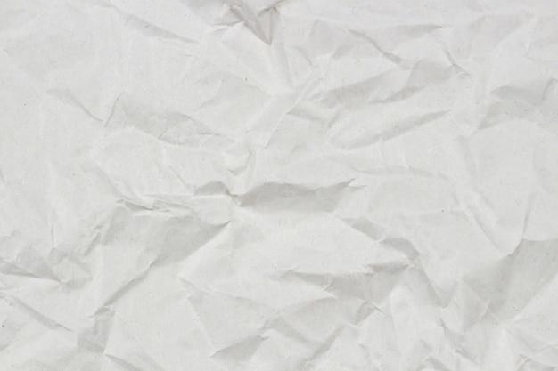 Vista superiore del fondo di struttura della carta da imballaggio stropicciata grigio chiaro