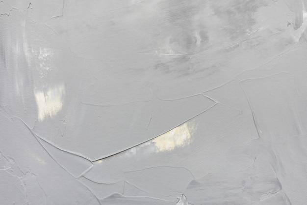 Fondo di struttura del muro di cemento o dello stucco ruvido grigio chiaro e giallo