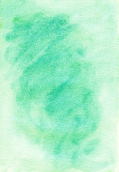 Sfondo acquerello verde chiaro dipinto su carta ruvida. sfondo color smeraldo pastello.