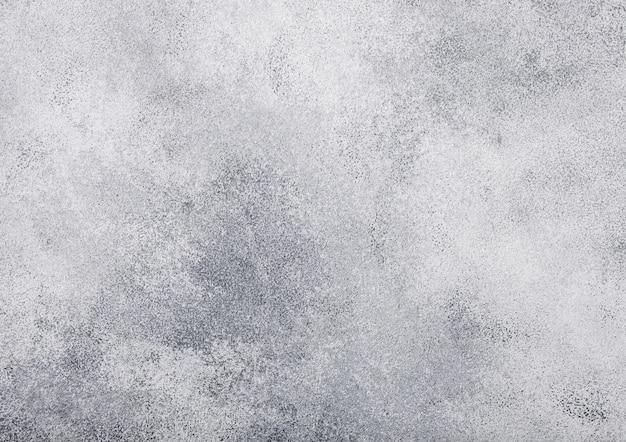 Fondo grigio chiaro di struttura della parete di pietra del cemento grigio. vista dall'alto