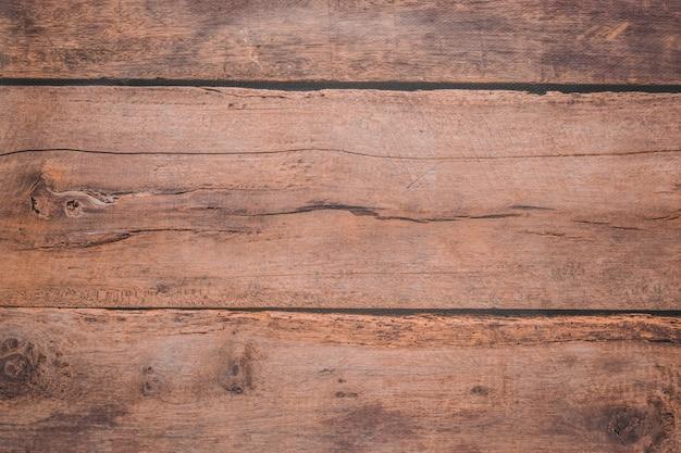 Fondo in legno chiaro per fotografie. trama marrone di un albero tagliato. copyspace.