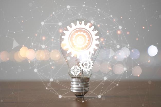 Lampadina con ingranaggi a cremagliera e linea di connessione. concetto di idea di pensiero creativo.