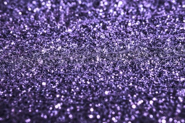 Lilla glitter texture scintillante sfondo lucido per la decorazione della carta da parati vacanza di natale, saluto e elemento di design della carta di invito a nozze, sfondo astratto di natale con lo spazio della copia.