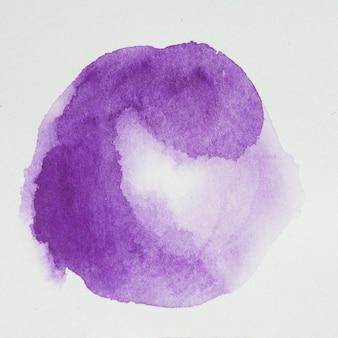 Lilla dipinge a forma di cerchio su carta bianca