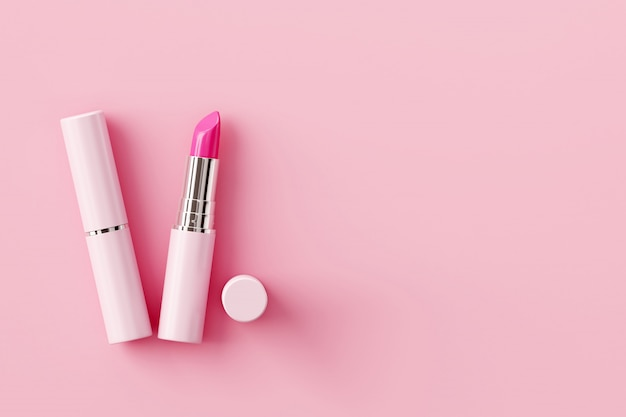 Rossetto su sfondo rosa pastello. concetto di bellezza.