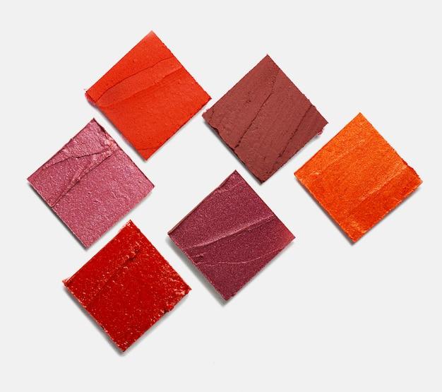 Sbavature di rossetto sfondo texture marrone nudo