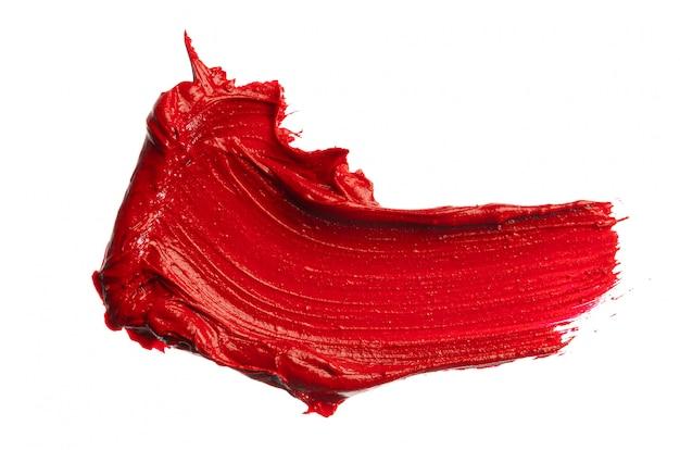 Campione di sbavature di rossetto isolato su sfondo bianco