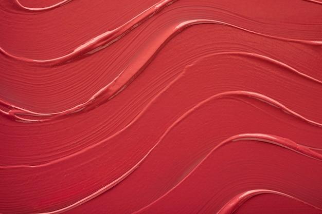 Rossetto macchia swatch texture sfondo colorato rosso