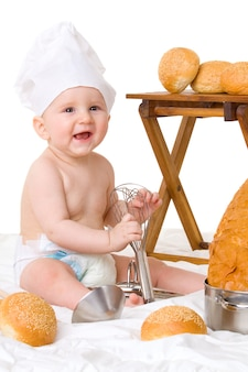 Little baby chef in costume da cuoco con pane