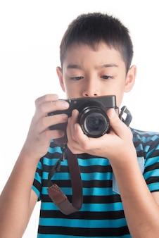Fotocamera della holding del ragazzino