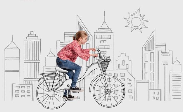Bambina che guida la bici sullo sfondo di schizzo città monocromatica immaginaria