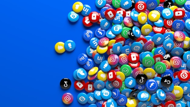 Molte pillole di social network su un blu fisso. un sacco di 3d multicolor social network lucido pillole su uno sfondo blu