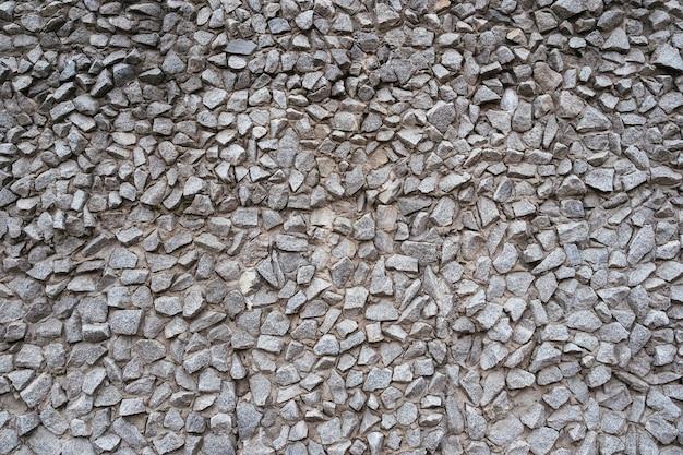 Molte pietre grigie nel cemento, trama. macerie grigie in cemento, sfondo.