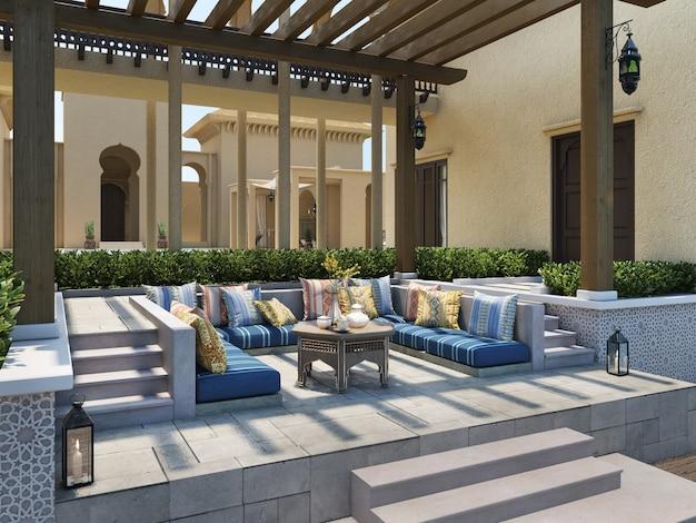 Padiglione lounge sulla terrazza con cuscini ispirati al design arabo