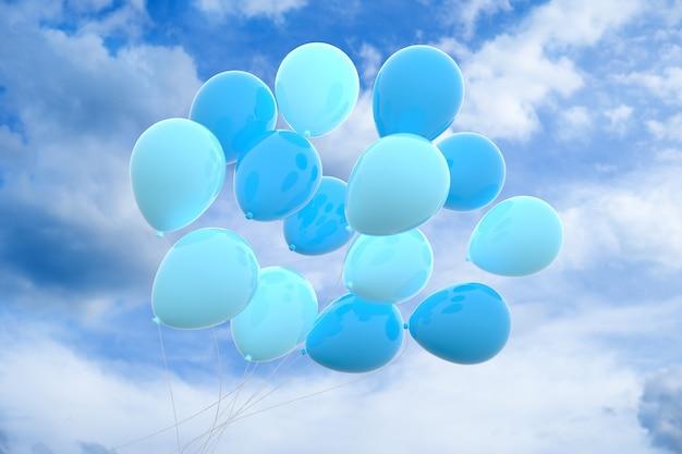 Inquadratura dal basso di palloncini blu sotto un cielo nuvoloso di giorno
