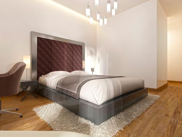Lussuoso letto matrimoniale nella camera d'albergo in art déco. una grande testiera imbottita e comodini con lampade da tavolo. rendering 3d.