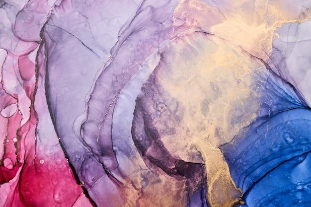 Fondo astratto variopinto di lusso nella tecnica dell'inchiostro dell'alcool, struttura di marmo dorata della pittura liquida, macchie acriliche sparse e macchie vorticose, materiali stampati
