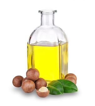 Olio di macadamia in bottiglia e noci
