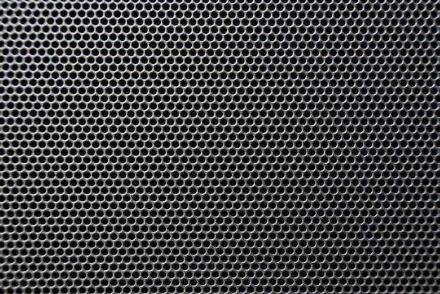 Ripresa macro del dettaglio della griglia dell'altoparlante, trama della griglia dell'altoparlante
