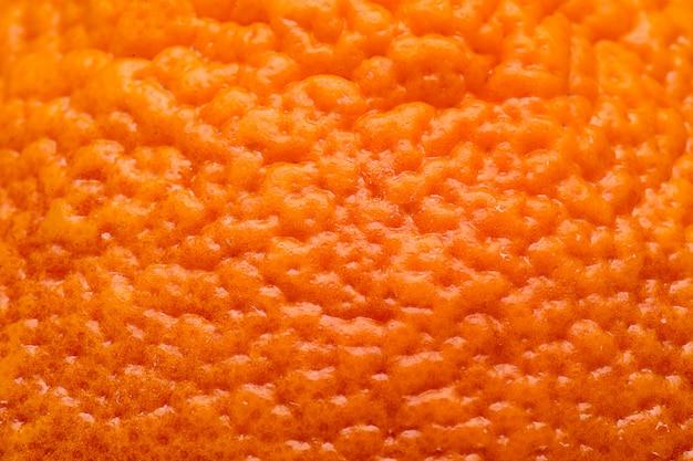 Macro vista sul fondo arancio di struttura della buccia della frutta