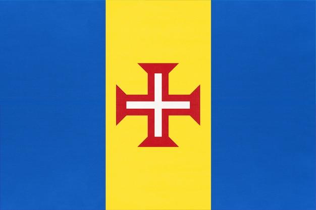 Madeira bandiera nazionale tessuto sfondo tessile. simbolo del mondo paese africano.