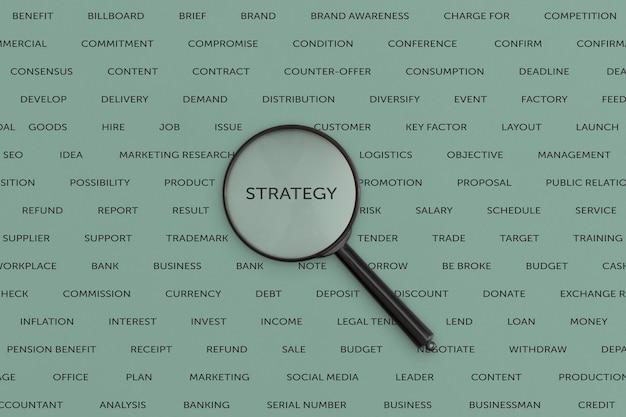 Lente d'ingrandimento con la scritta strategia, concetto di affari.