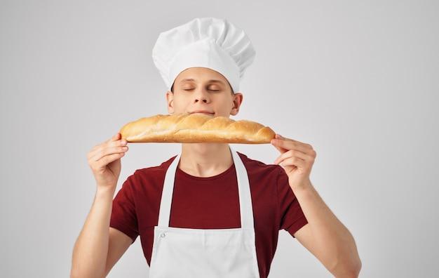 Grembiule cuoco maschio cucina cucina ristorante lifestyle. foto di alta qualità