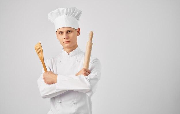 Grembiule da cuoco maschio che cucina lo stile di vita del ristorante della cucina. foto di alta qualità