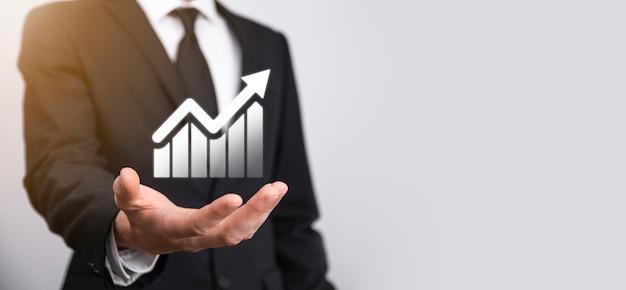 Simbolo maschio dell'icona del grafico della tenuta della mano che controlla l'analisi del grafico del grafico di crescita dei dati di vendita e del mercato azionario sulla rete globale. strategia aziendale, pianificazione e marketing digitale
