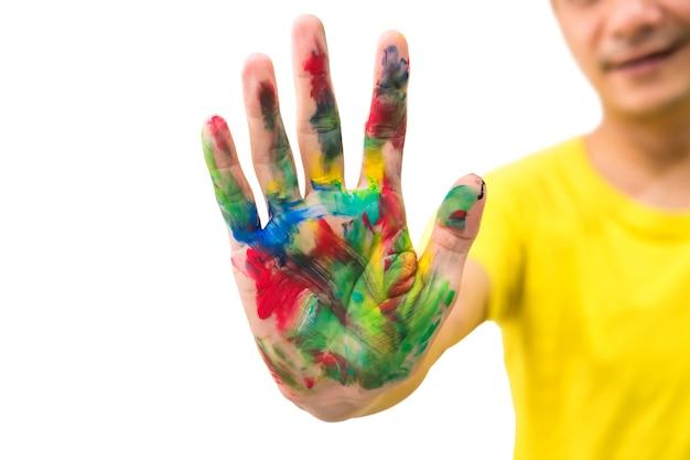 Mano dell'uomo, spalmata di vernice multicolore isolata.