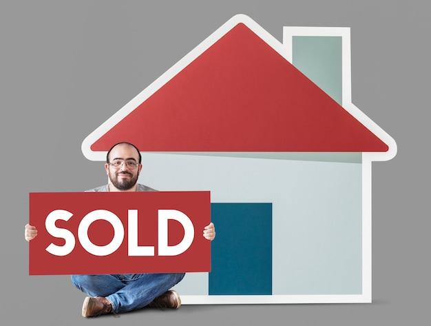 Manifesto della tenuta dell'uomo con il modello della casa