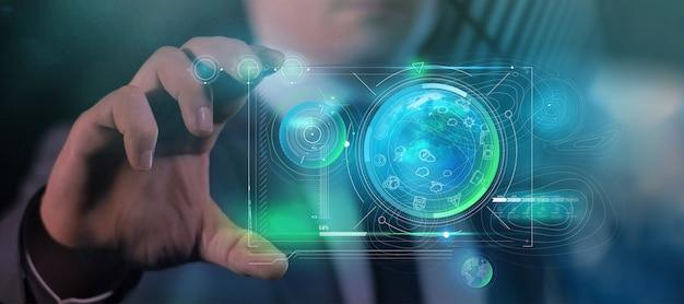 Un uomo tiene in mano un dispositivo futuro con una proiezione infografica sulla terra.